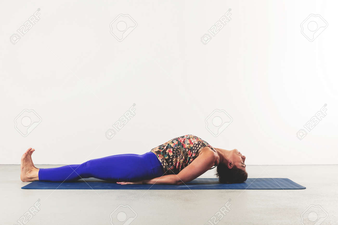 woman in yoga fish pose position on white background - 170379933