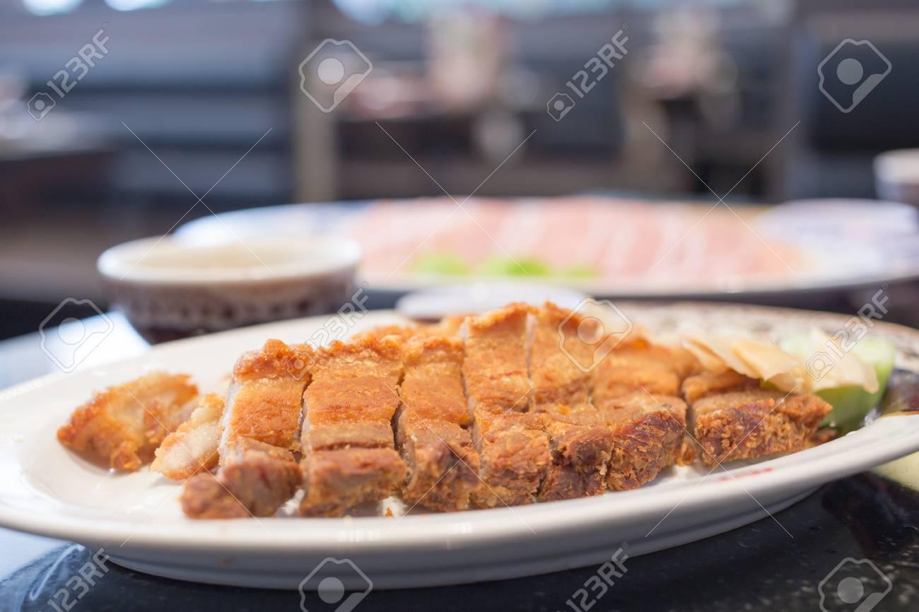 Crispy pork cut into pieces on the plate - 81739949
