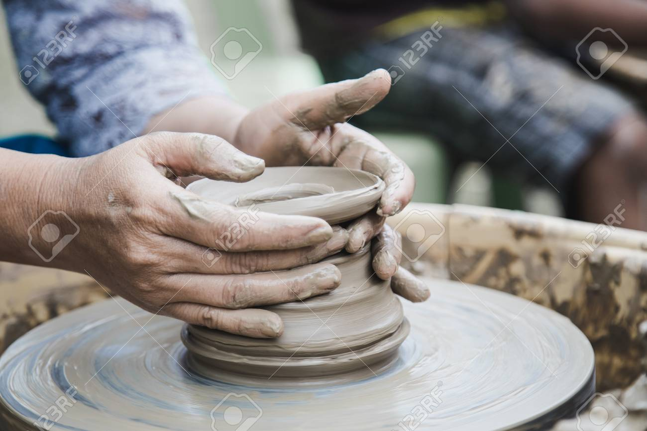 Closed up hands man using mechanic pottery made earthenware. - 99278063