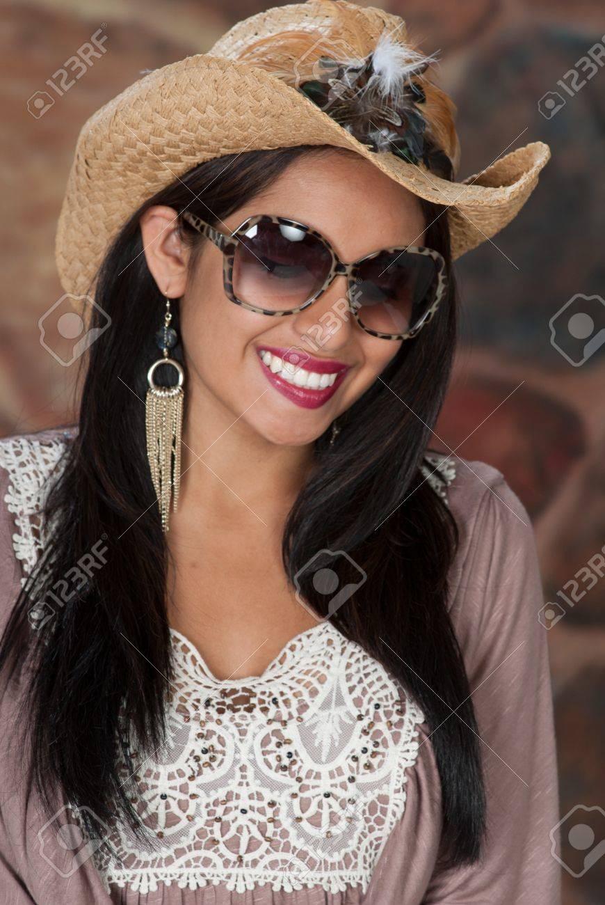 Stock Photo - Woman wearing cowboy hat and sunglasses. fe7b029db93d