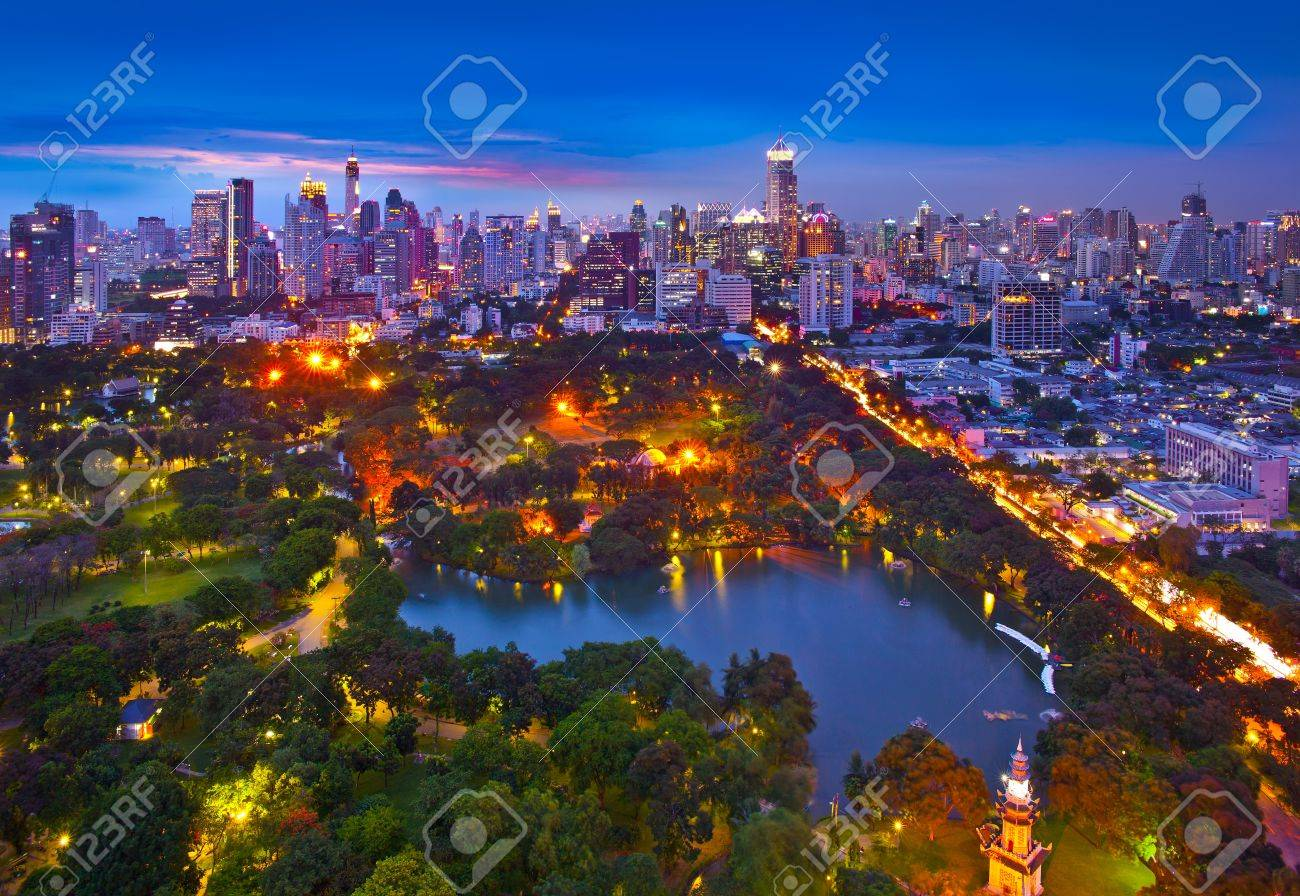 Night urban city skyline in a green environment, Suan Lum, Bangkok, Thailand  Suan Lum Lumpini Park is green space in Bangkok, Thailand Stock Photo - 19903841