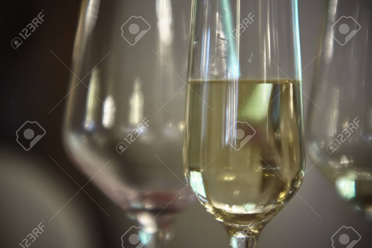 Detail Of A Glass Full Of White Wine On The Table For Happy Hour - The table happy hour