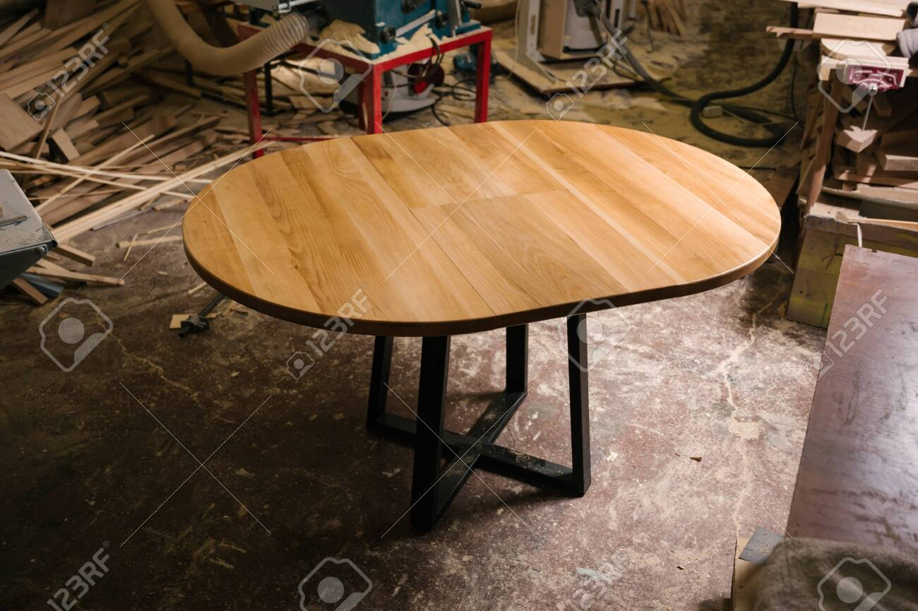 Brown Light Brown Wooden Round Dining Table Modern Designer Stock Photo Picture And Royalty Free Image Image 149193863