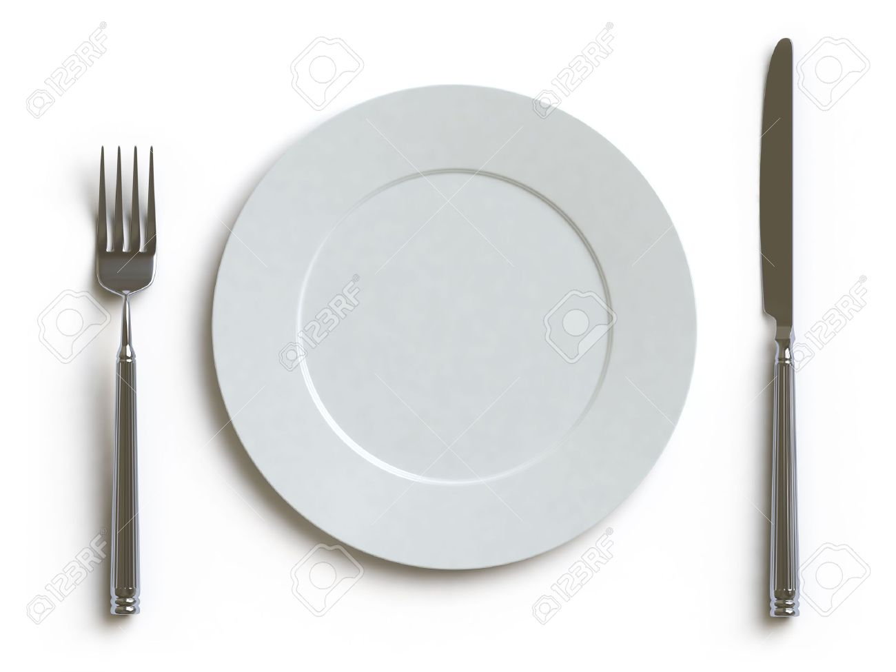 An empty white dish with knife and fork on a table - Empty Dish Fork And Knife Stock Photo 4720569