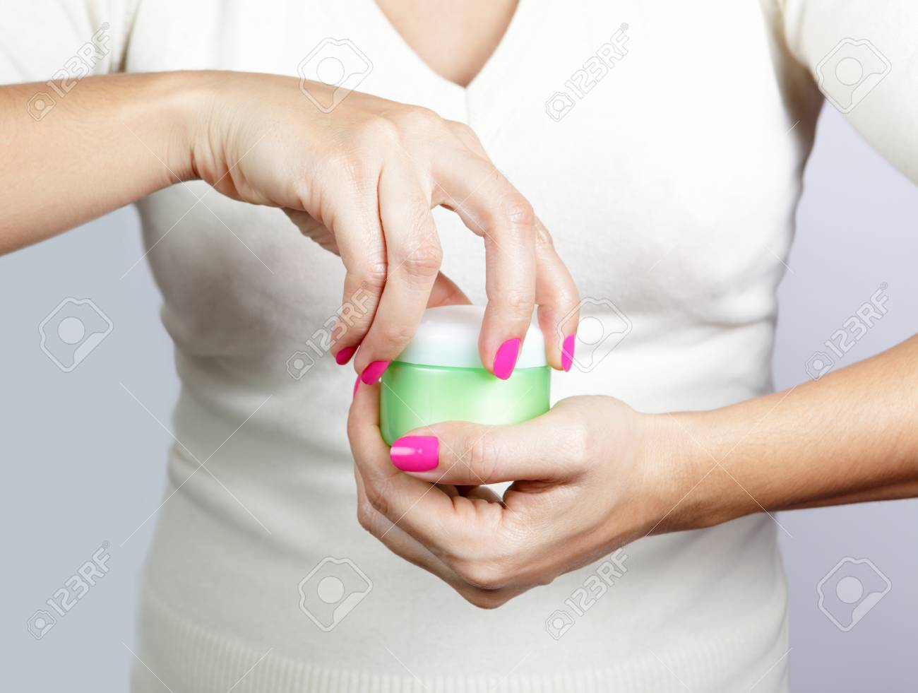 Female hands with jar of body Stock Photo - 15129279