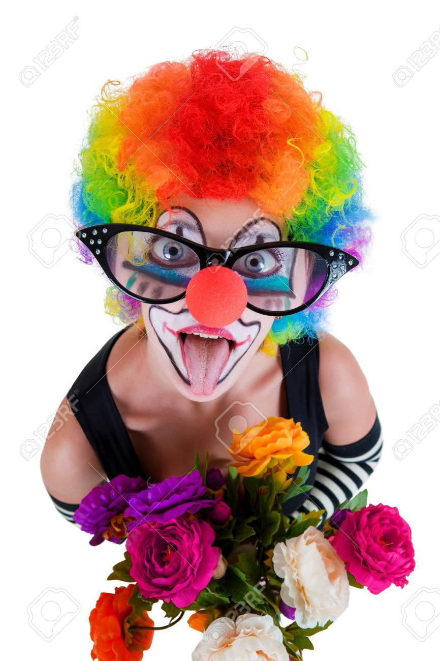 Girl In Big Red Glasses And Clown Costume With A Bouquet Of Flowers ...