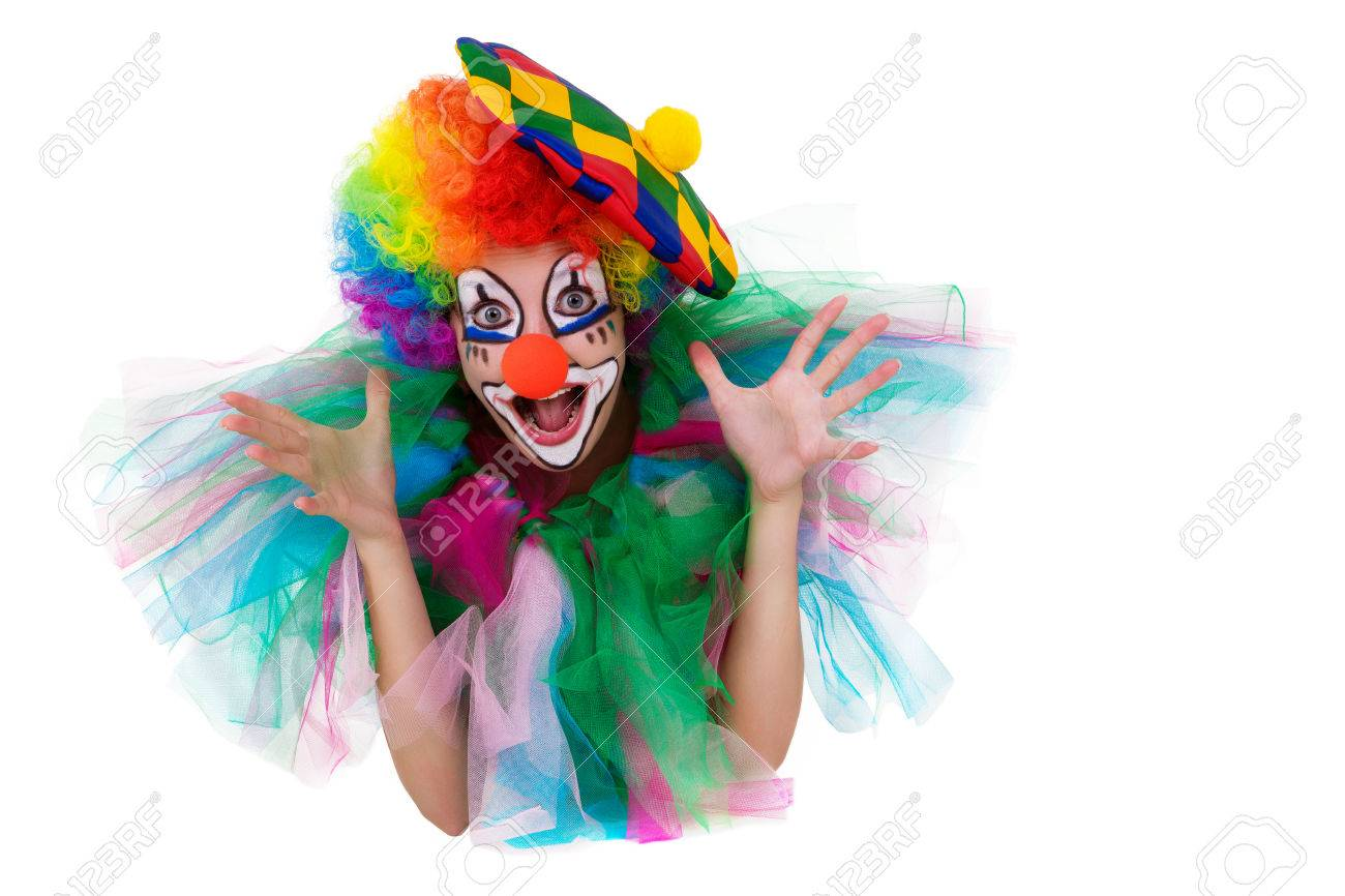 Girl In Cap And Clown Costume With A Bouquet Of Flowers Puts.. Stock ...