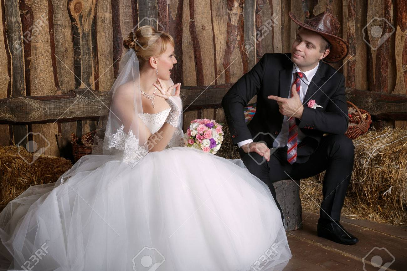 70d2d669d38 Portrait of the bride and groom in a cowboy hat Stock Photo - 48571414