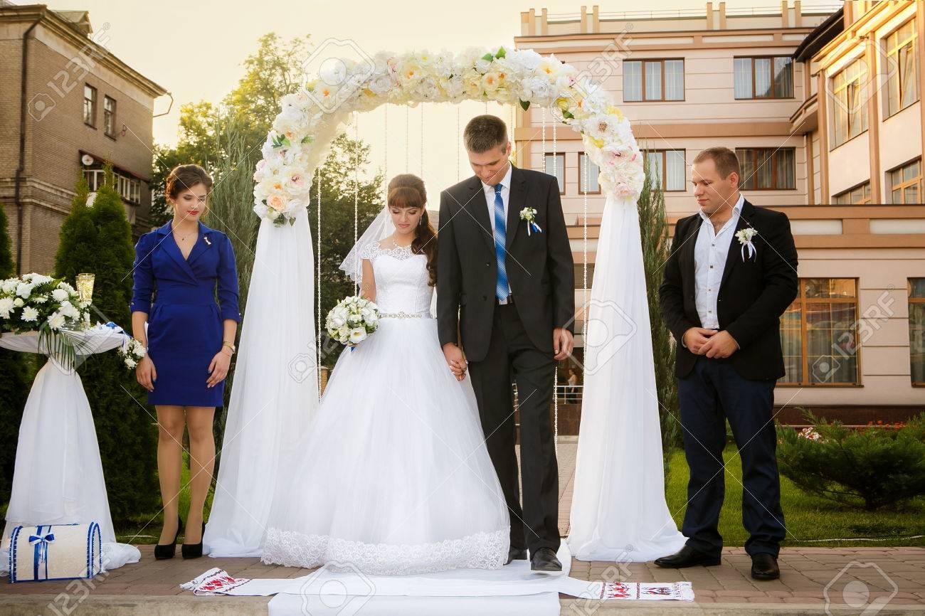 wedding couple , groomsman and bridesmaid are during wedding ceremony - 55438997