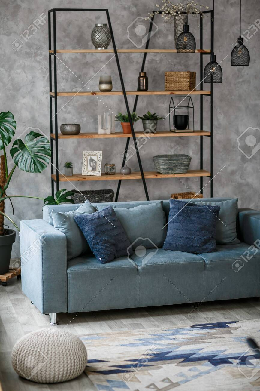 Modern Living Room Interior With Blue Sofa Lamp And Green Plants.. Stock Photo, Picture And Royalty Free Image. Image 123273221.