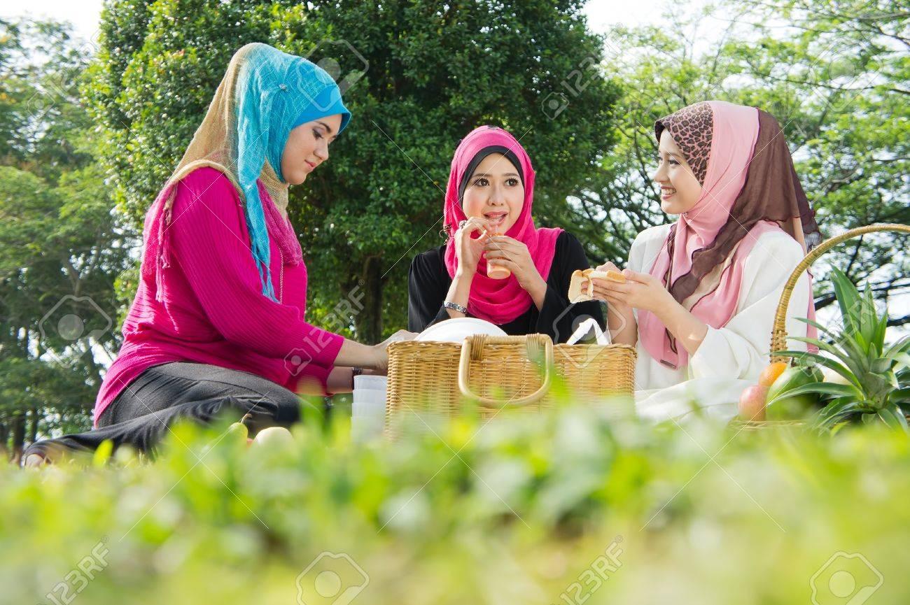 Beautiful Muslim girlfriends on picnic at park Stock Photo - 10612810