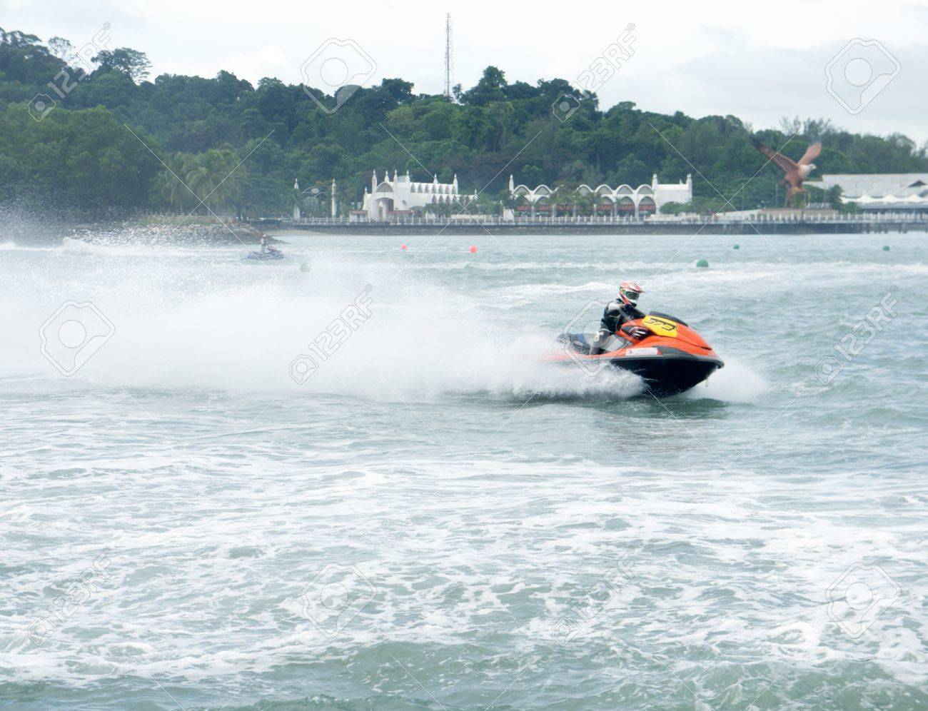 LANGKAWI, MALAYSIA - APRIL 13 : Unidentified rider pumps up his machine during Langkawi International Formula Jet Ski Super Series, April 13, 2012 in Langkawi, Malaysia. Stock Photo - 13154515