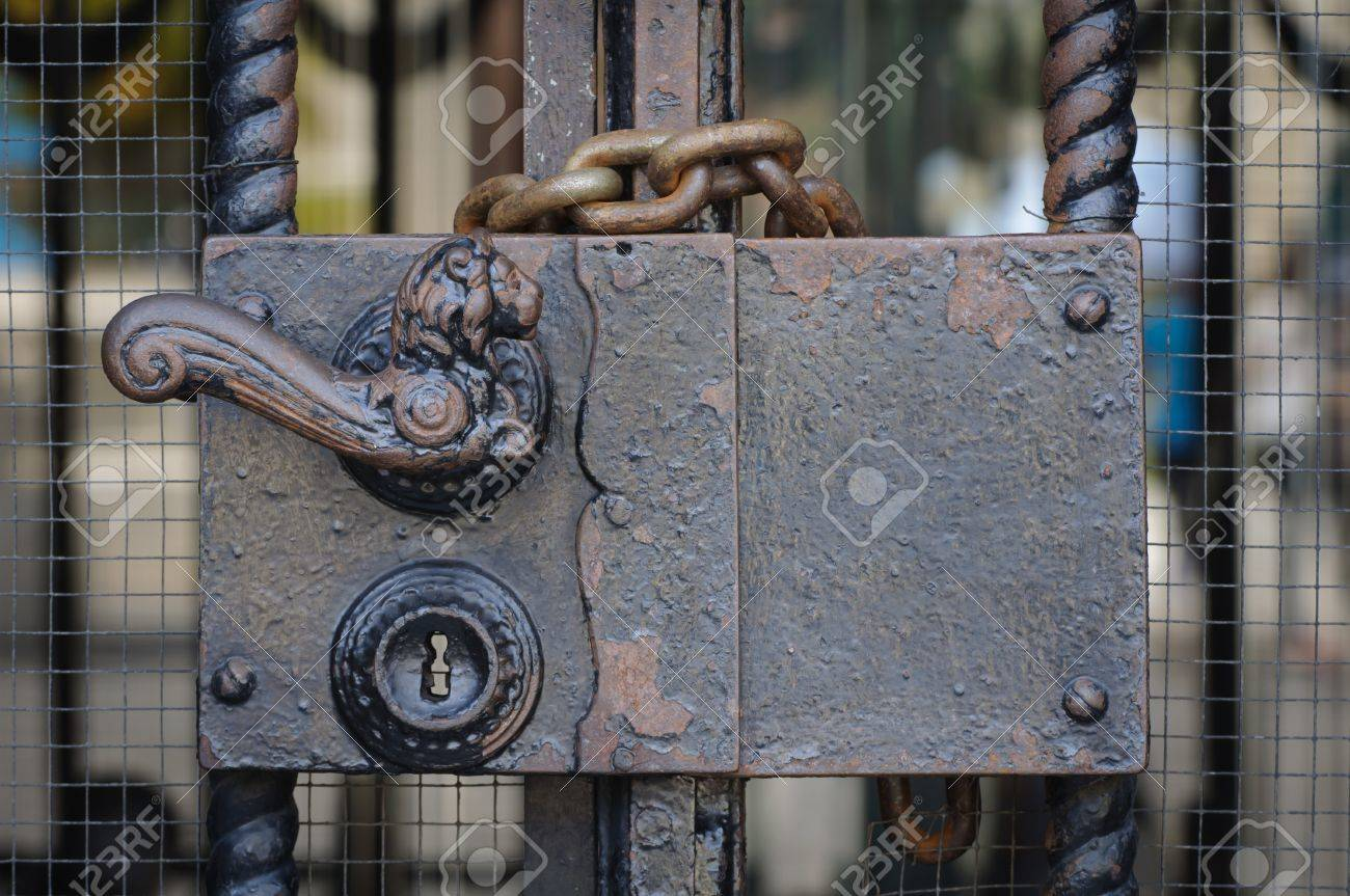 AntiqueThe steel handle lock gates to private property Stock Photo - 15717555