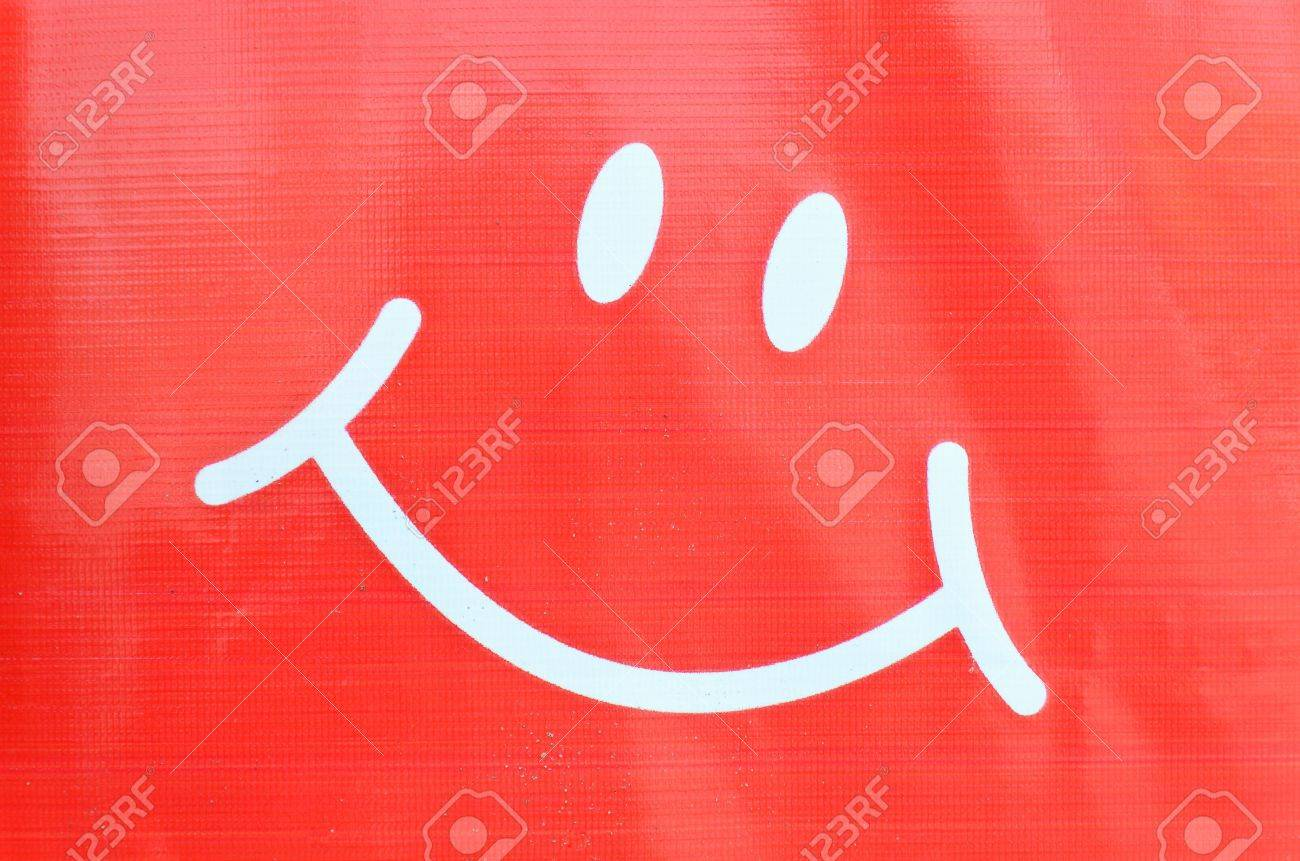 Smiley face symbol on plastic background Stock Photo - 18839583