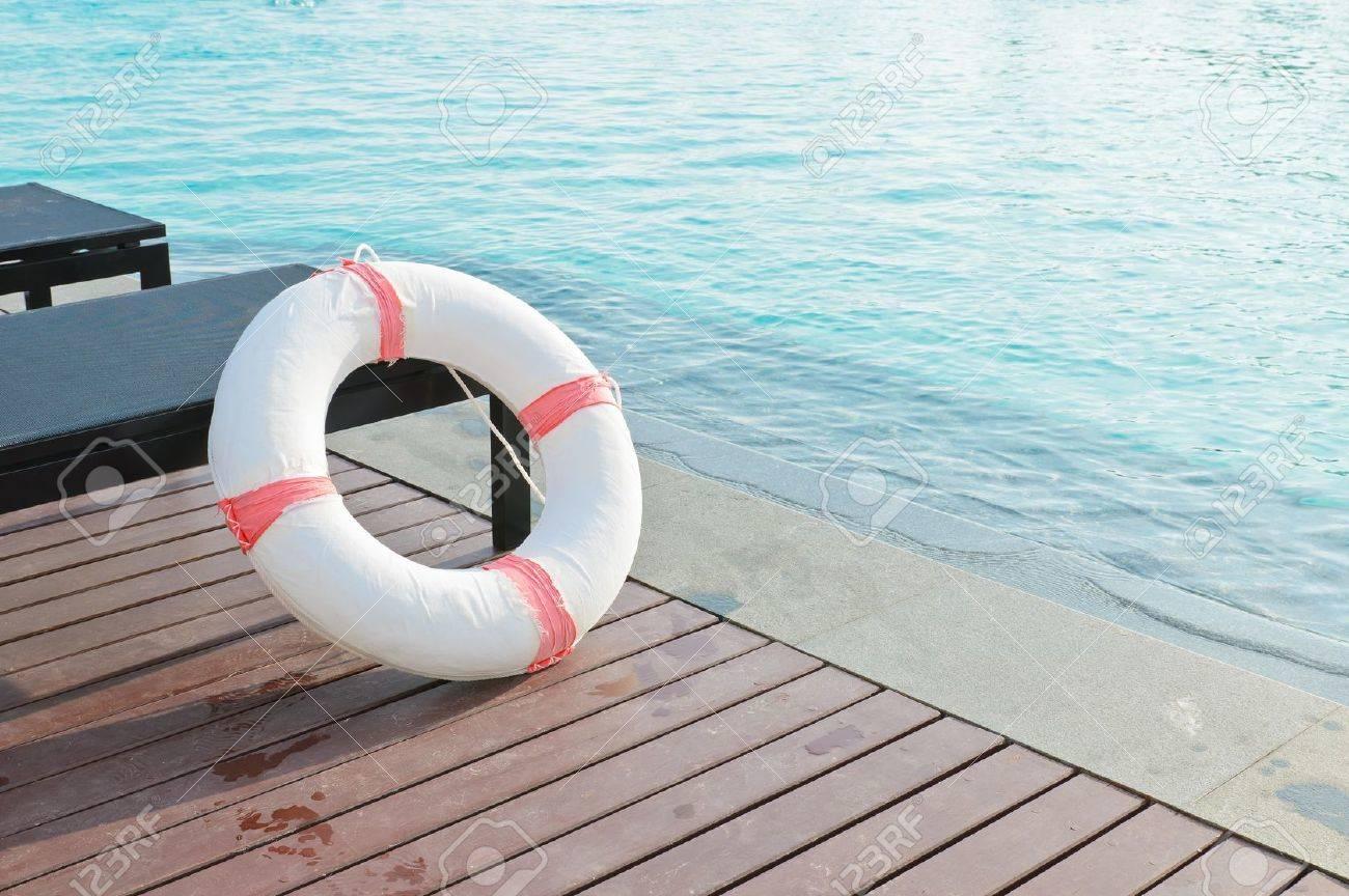 Lifebuoy beside the pool Stock Photo - 19587186
