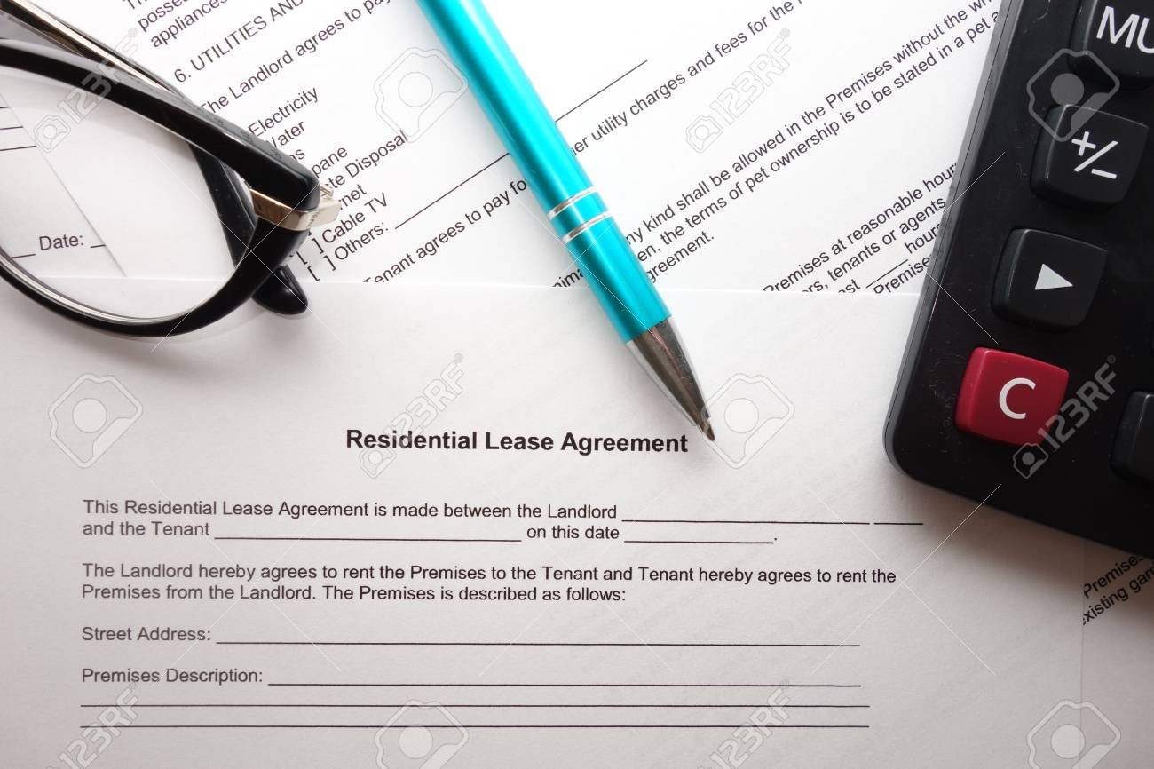 Blank Residential Lease Agreement With Pen Calculator And Glasses