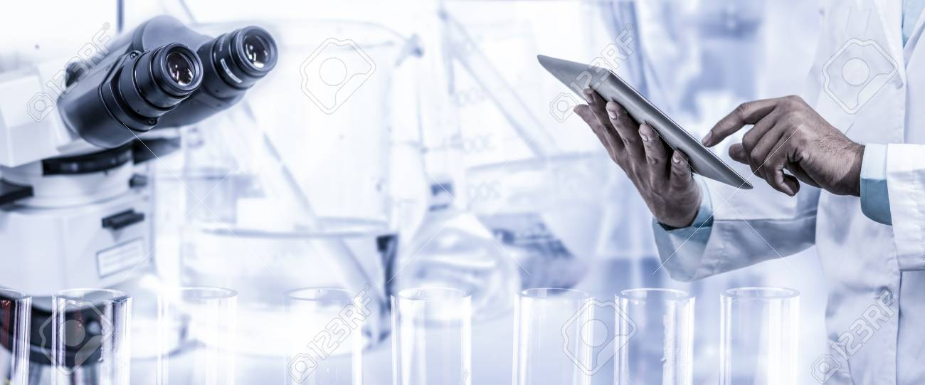 Science research and technology concept - Scientist holding tablet computer with scientific instrument, microscope and chemical test tube in lab background. - 81430716