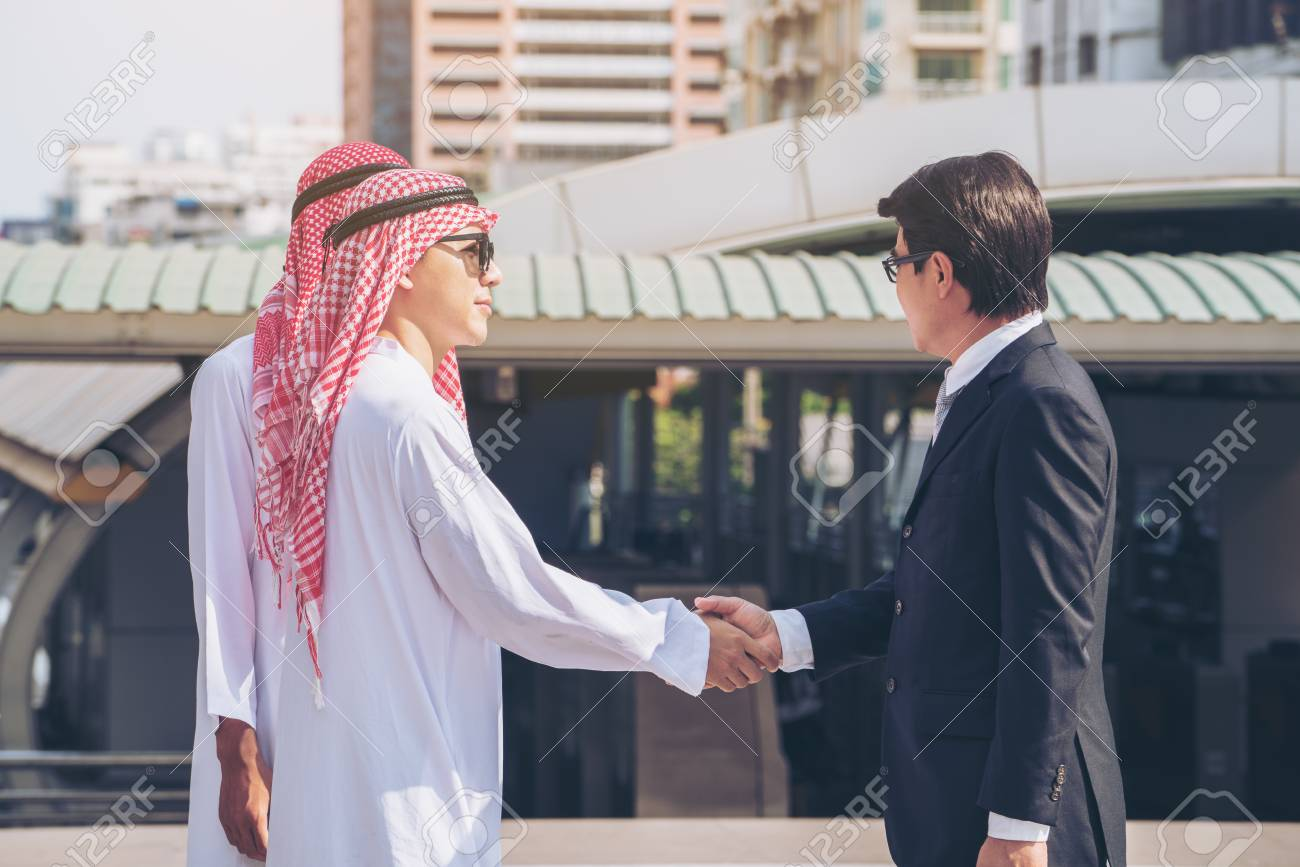 Arabic, Asian Businessmen Discussion In Business Meeting. Modern.. Stock Photo, Picture And Royalty Free Image. Image 86125113.
