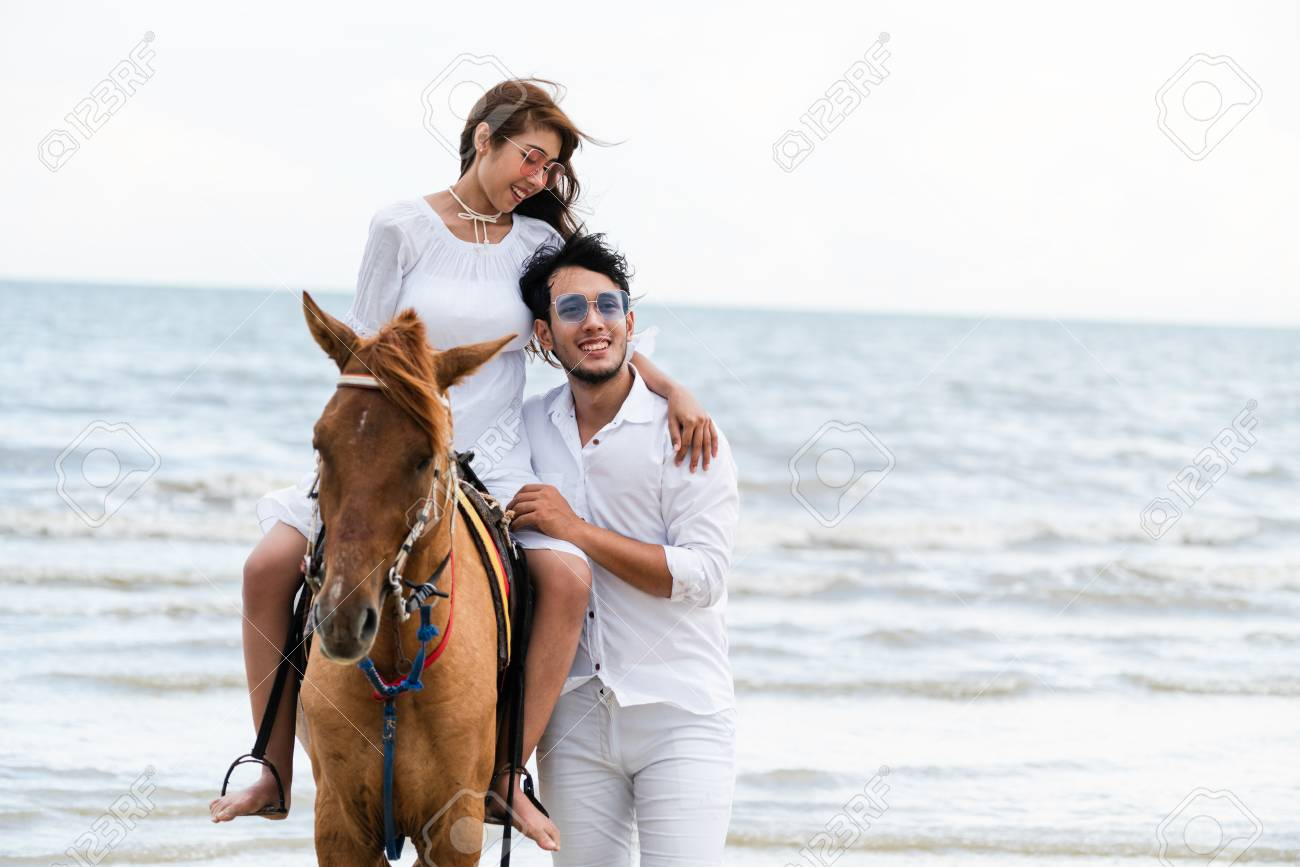 Young Couple Goes Honeymoon Horse Riding On The Beach In Summer Stock Photo Picture And Royalty Free Image Image 107344882