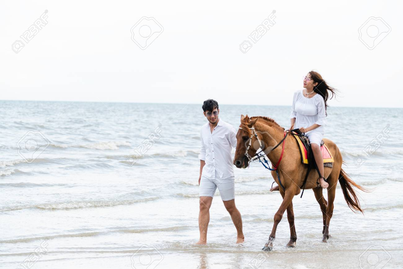 Young Couple Goes Honeymoon Horse Riding On The Beach In Summer Stock Photo Picture And Royalty Free Image Image 111069337