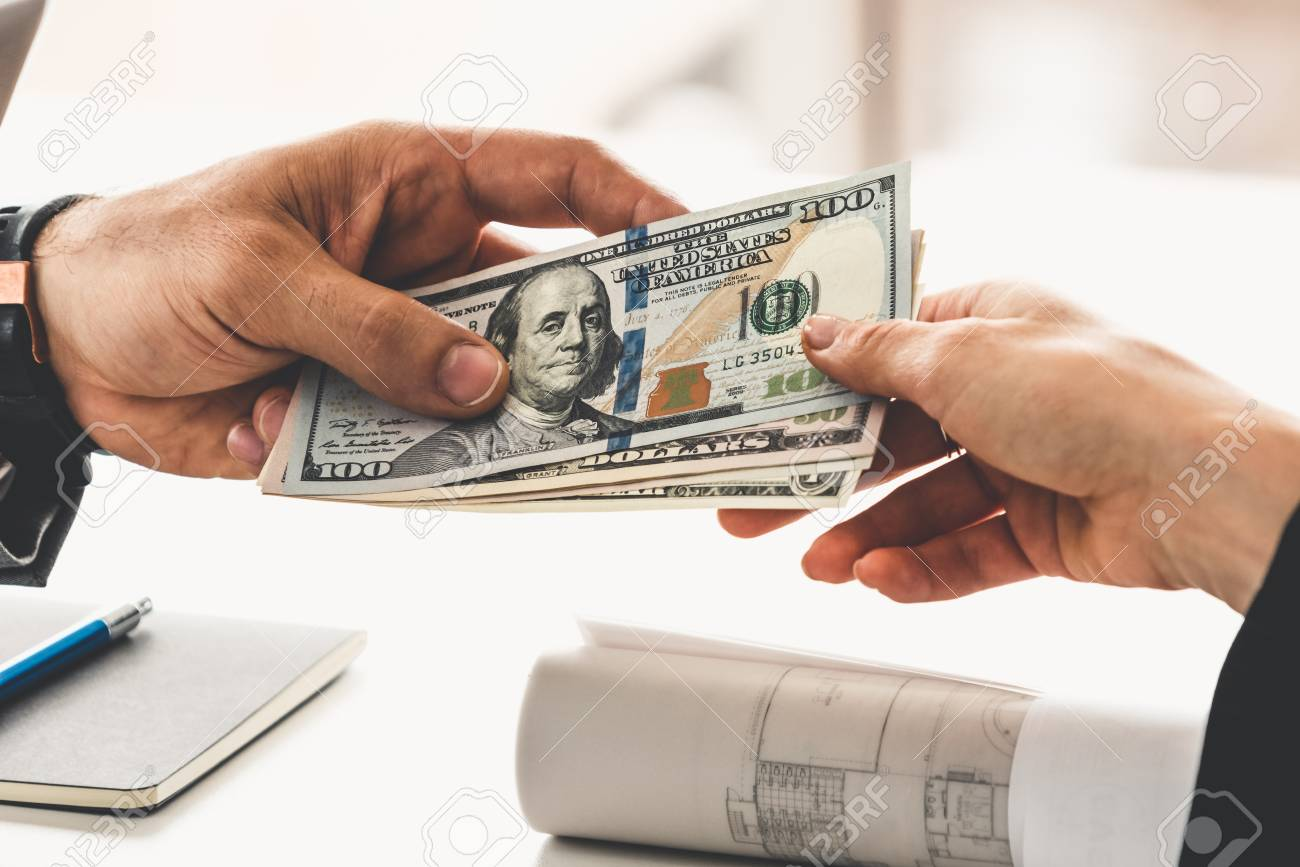 Businessman hand sending money to another business person. Transaction, payment, salary and banking concept. - 116326347