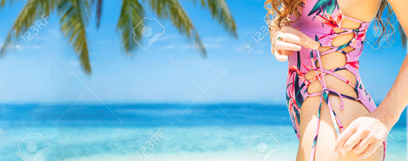 Happy young woman wearing swimsuit at tropical sand beach resort in summer for holiday travel vacation. - 121832895