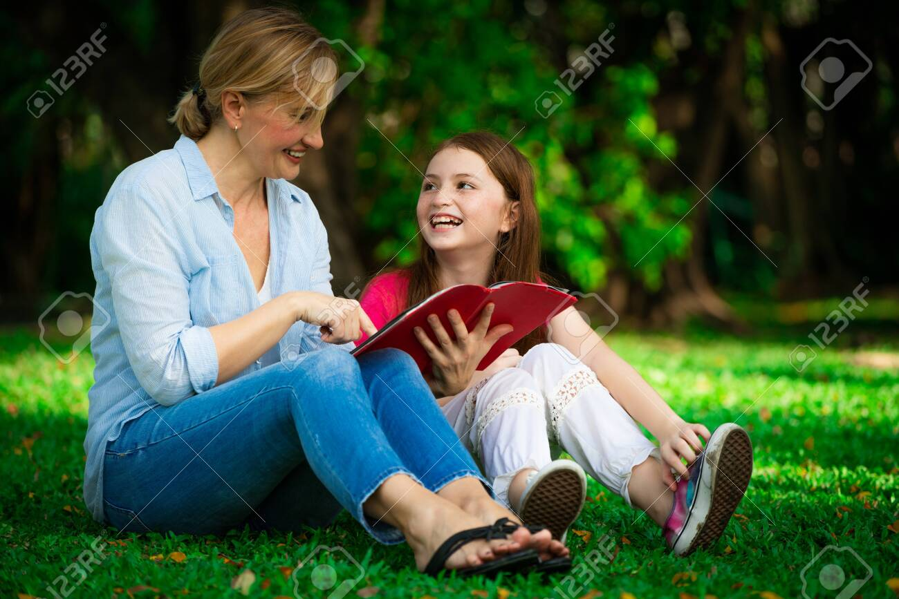 Relaxed happy mother and little kid daughter in outdoors public park. Parenthood and child concept. - 121833561