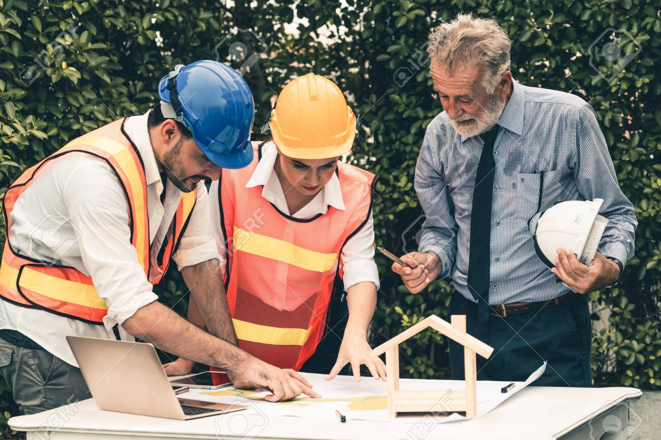 Engineer, architect and business man working on the engineering project at construction site. House building concept. - 120250905
