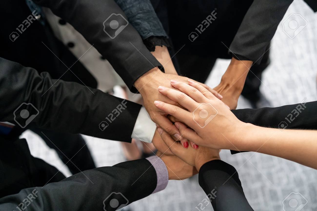 Many happy business people stacking hands together with joy and success. Company employee celebrate after finishing successful work project. Corporate partnership and achievement concept. - 120255301