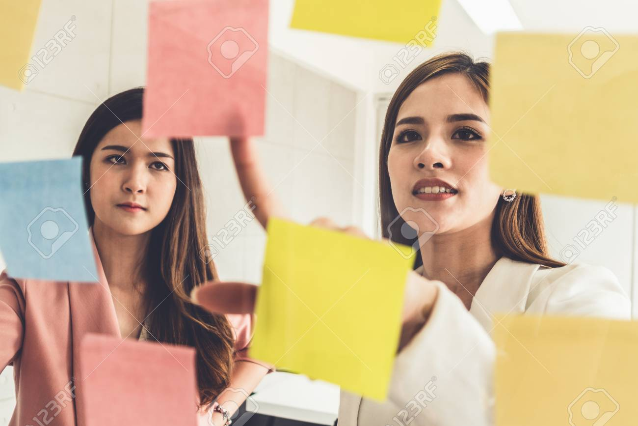Creative Asian businesswoman in meeting workshop coming up with many positive ideas to help developing their corporate business. Group discussing and brainstorm concept. - 120383701