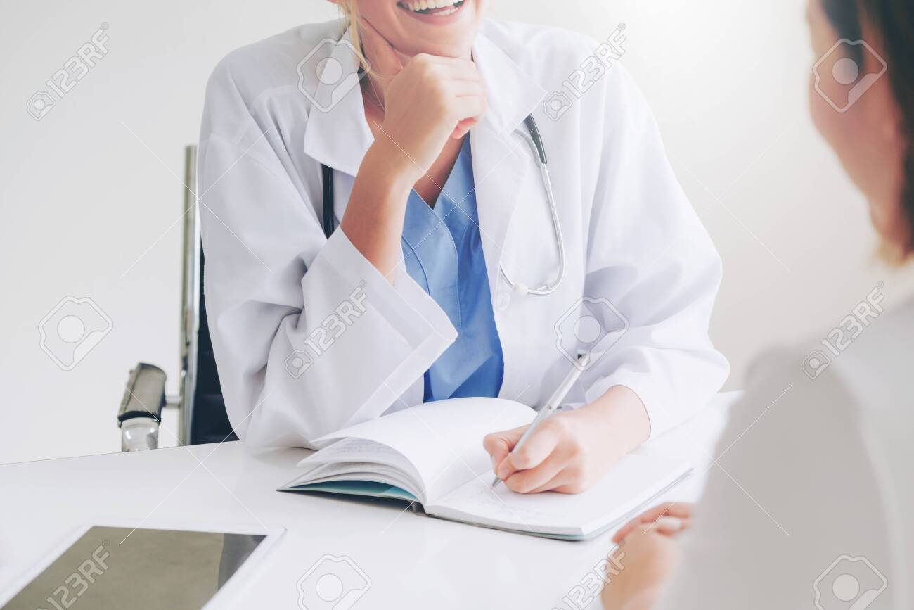 Female patient visits woman doctor or gynecologist during gynaecology check up in office at the hospital. Gynecology healthcare and medical service. - 121492590