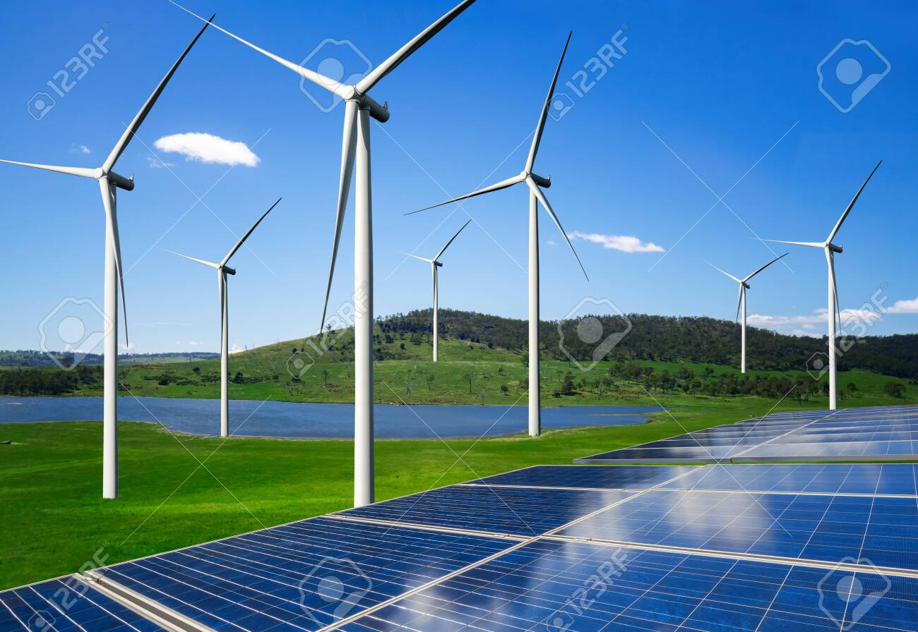 Solar energy panel photovoltaic cell and wind turbine farm power generator in nature landscape for production of renewable green energy is friendly industry. Clean sustainable development concept. - 124507499