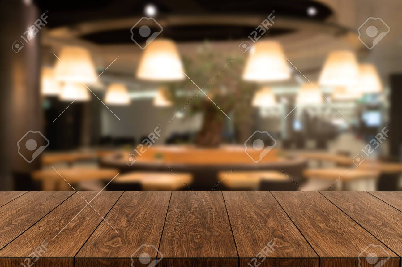 Wood table in blurry background of modern restaurant room or coffee shop with empty copy space on the table for product display mockup. Interior restaurant counter design concept. - 128878508