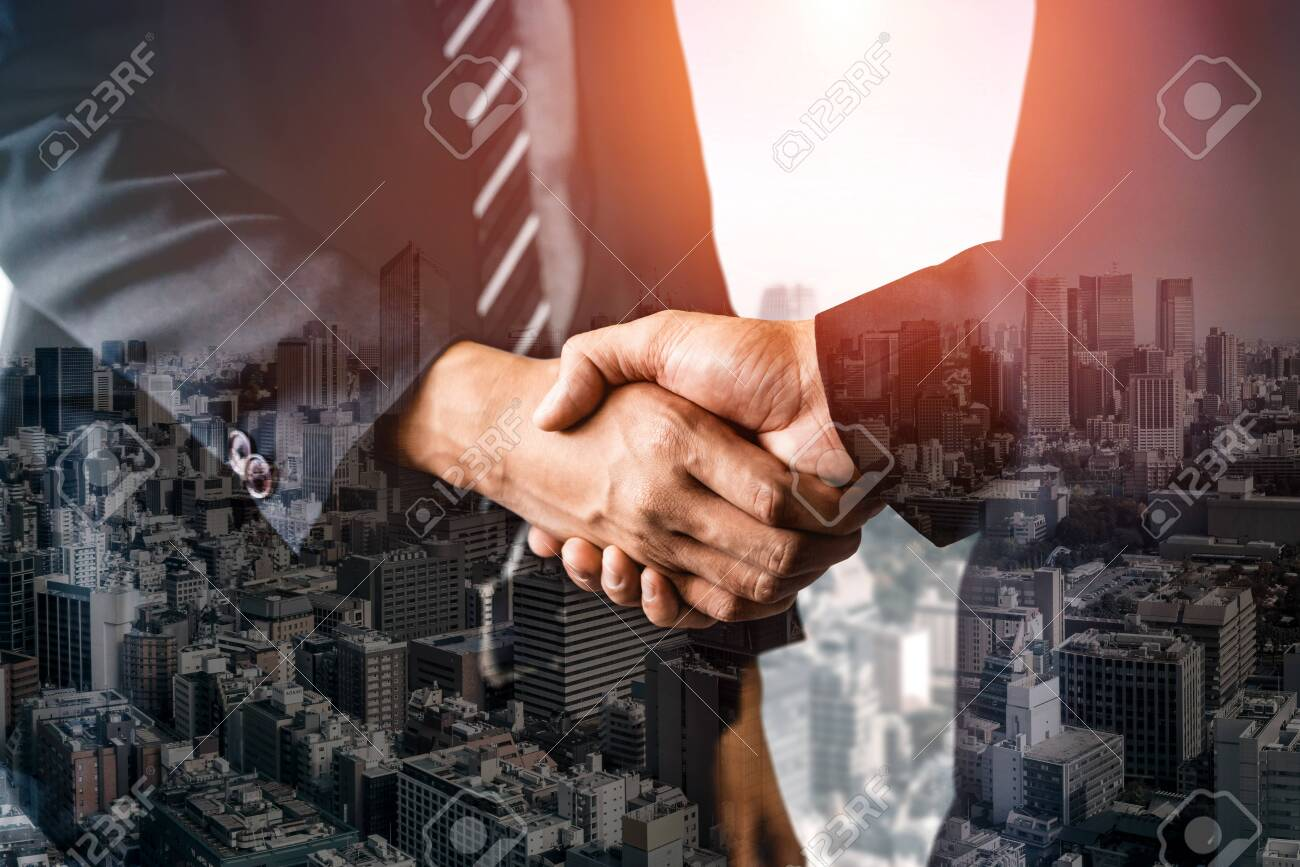 Double exposure image of business people handshake on city office building in background showing partnership success of business deal. Concept of corporate teamwork, trust partner and work agreement. - 130416477