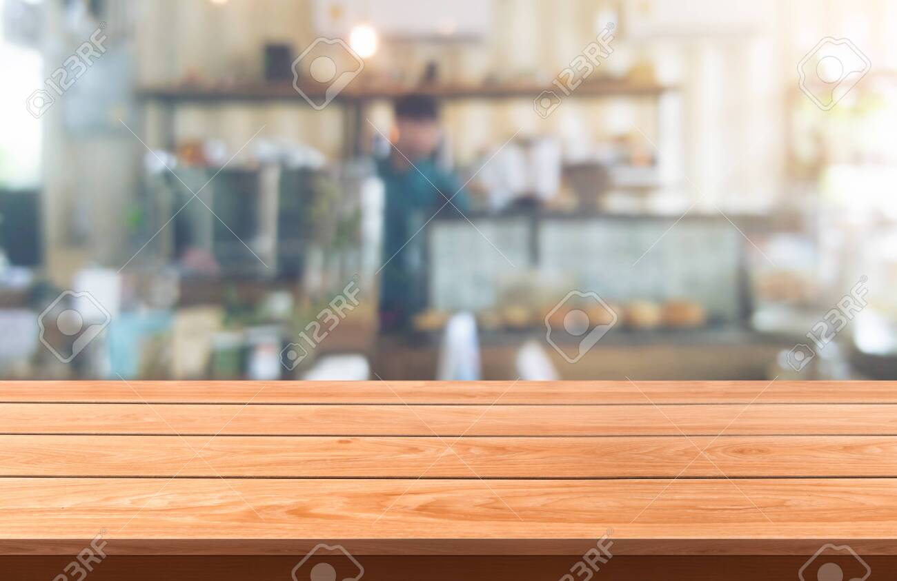 Wood table in blurry background of modern restaurant room or coffee shop with empty copy space on the table for product display mockup. Interior restaurant counter design concept. - 131289781