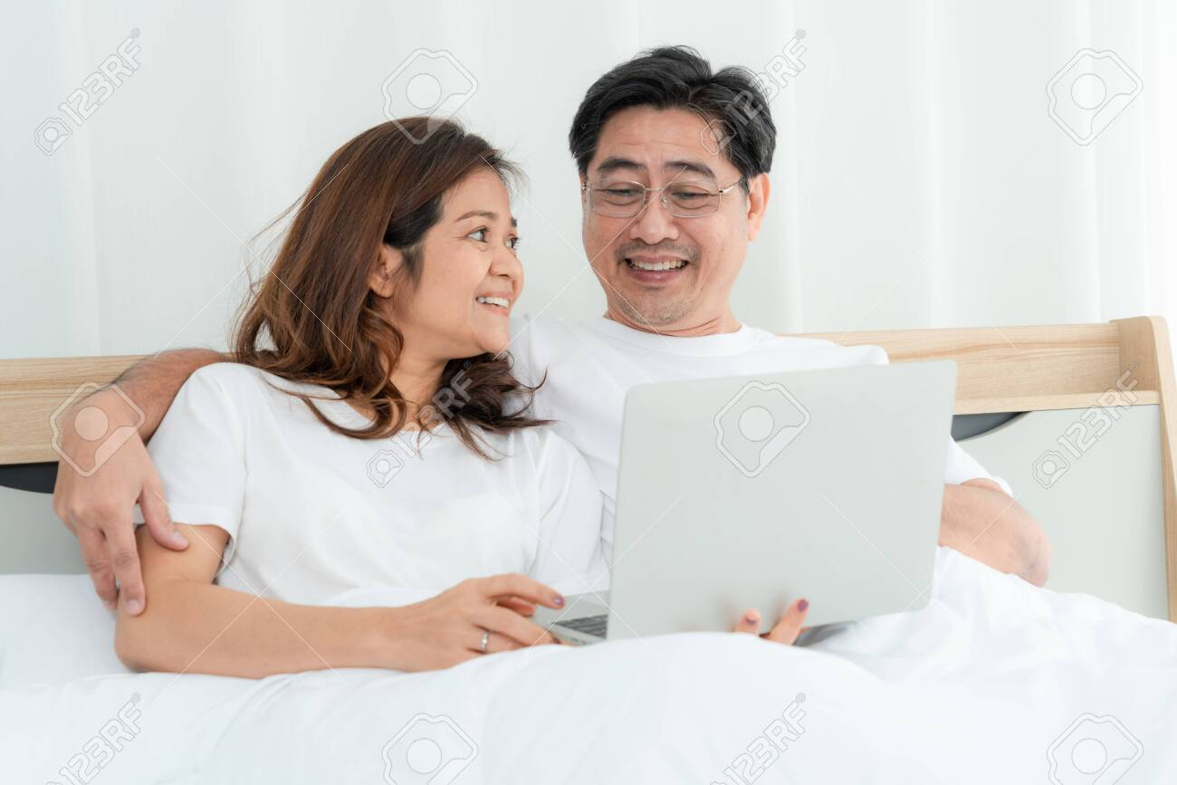 Happy Asian senior couple having good time at home. Old people retirement and healthy citizens elderly concept. - 140217569