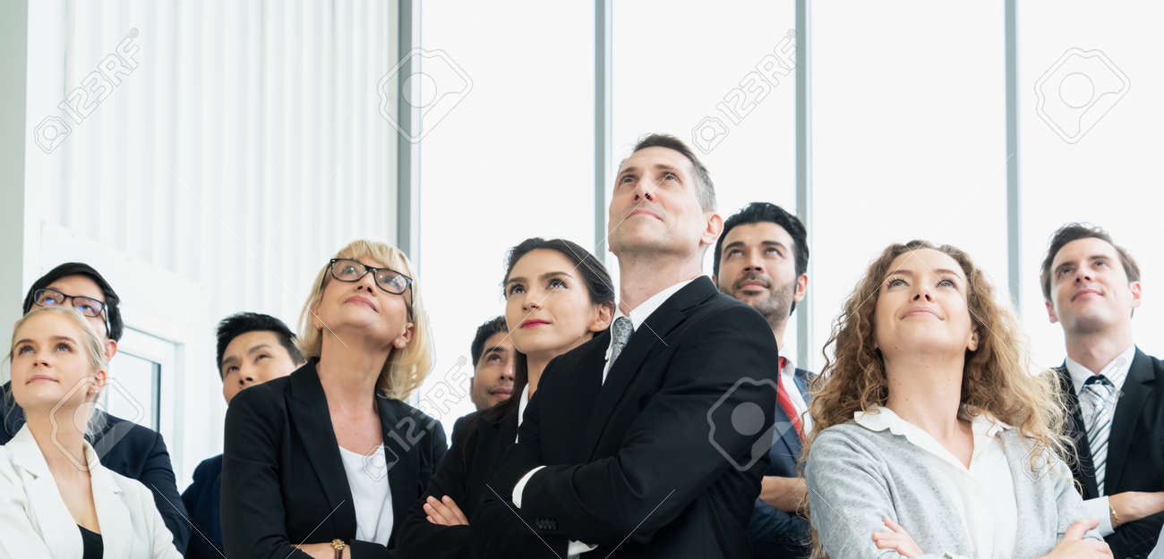 Successful business people standing together showing strong relationship of worker community. A team of businessman and businesswoman expressing a strong group teamwork at the modern office. - 156027287