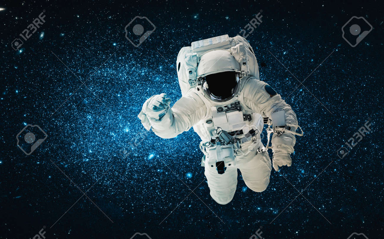 Astronaut spaceman do spacewalk while working for space station in outer space . Astronaut wear full spacesuit for space operation . - 166197298