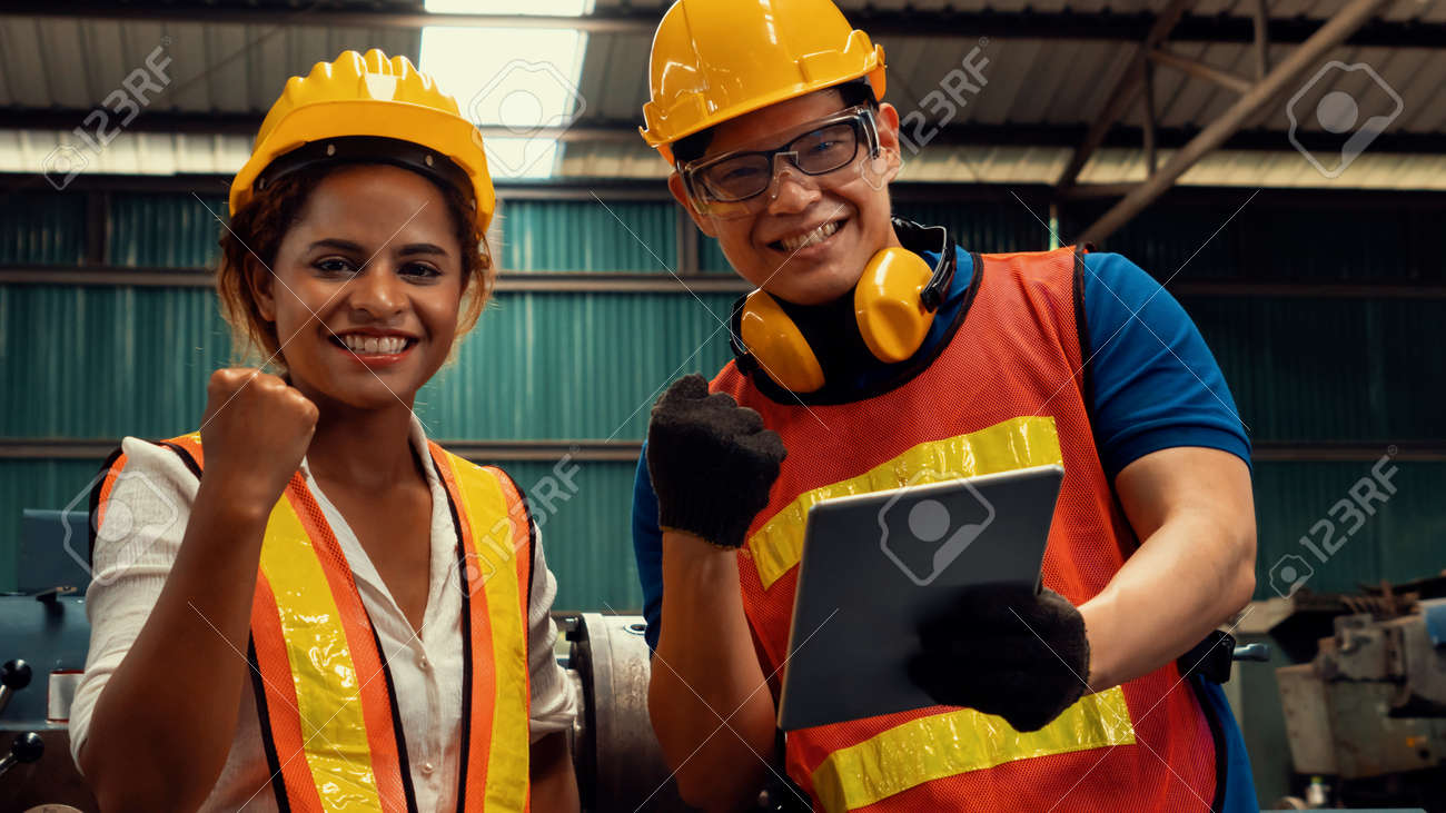 Two skillful factory engineer or worker happy portrait looking at camera . Industrial people and manufacturing labor concept . - 168031646