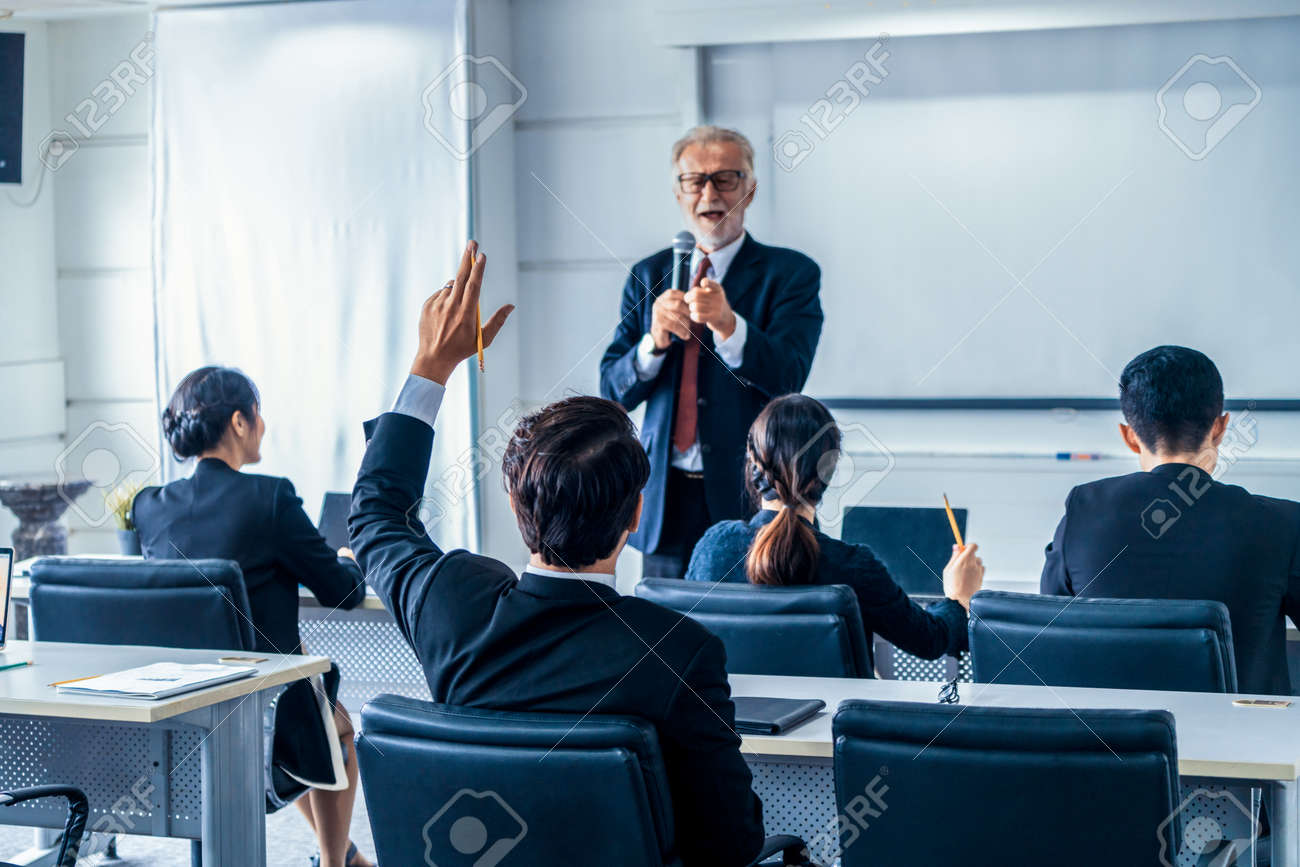 Senior leader speaker speaks to public people audience in training workshop or conference. Mature lecturer is CEO executive manager leading the symposium event. International business seminar concept. - 168566591
