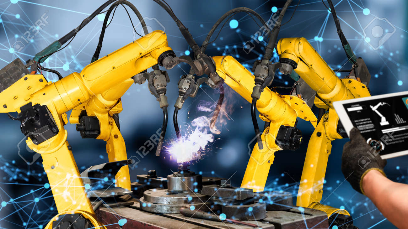 Smart industry robot arms modernization for innovative factory technology . Concept of automation manufacturing process of Industry 4.0 or 4th industrial revolution and IOT software control operation. - 169530418