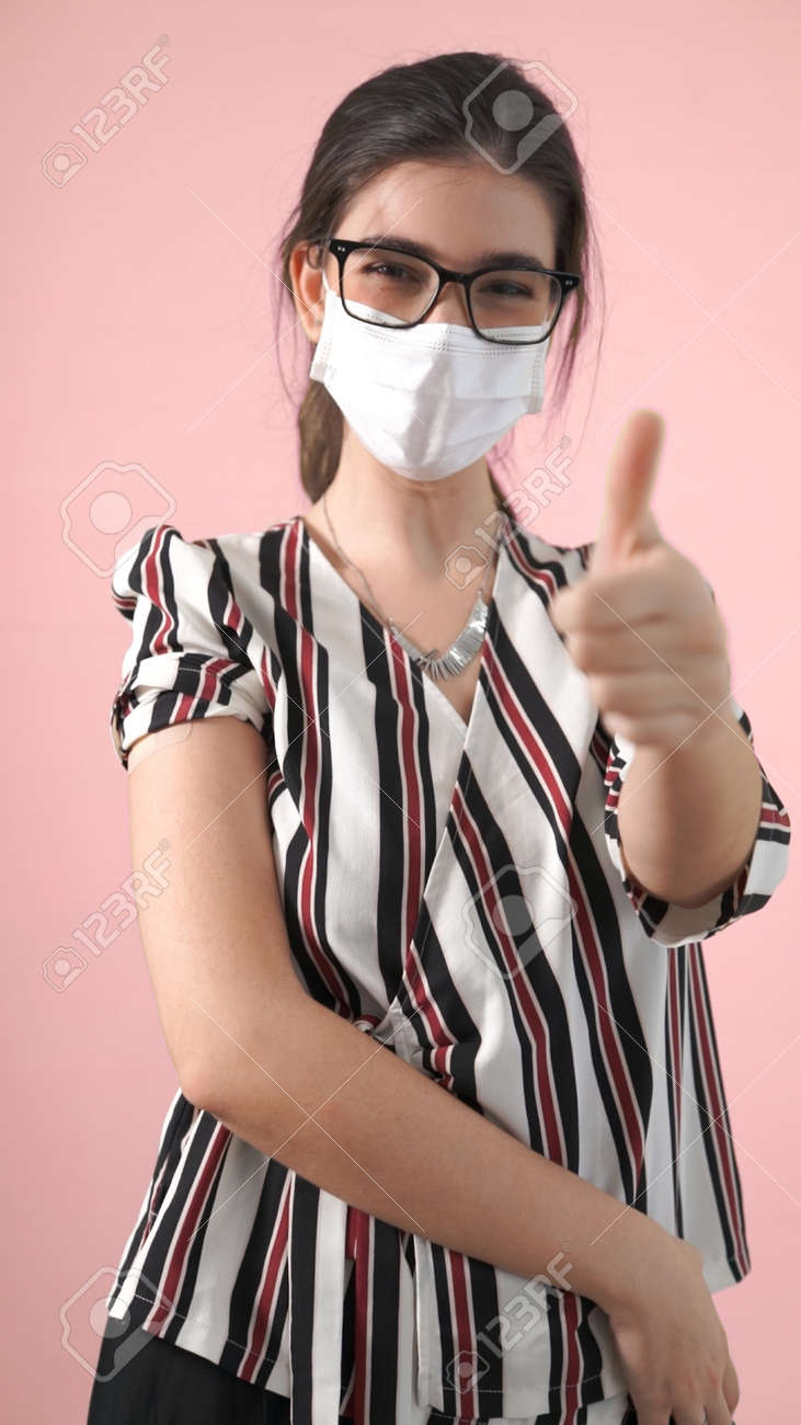 Young woman showing COVID-19 vaccine bandage merrily in concept of coronavirus vaccination program to vaccinate citizen . - 171905636