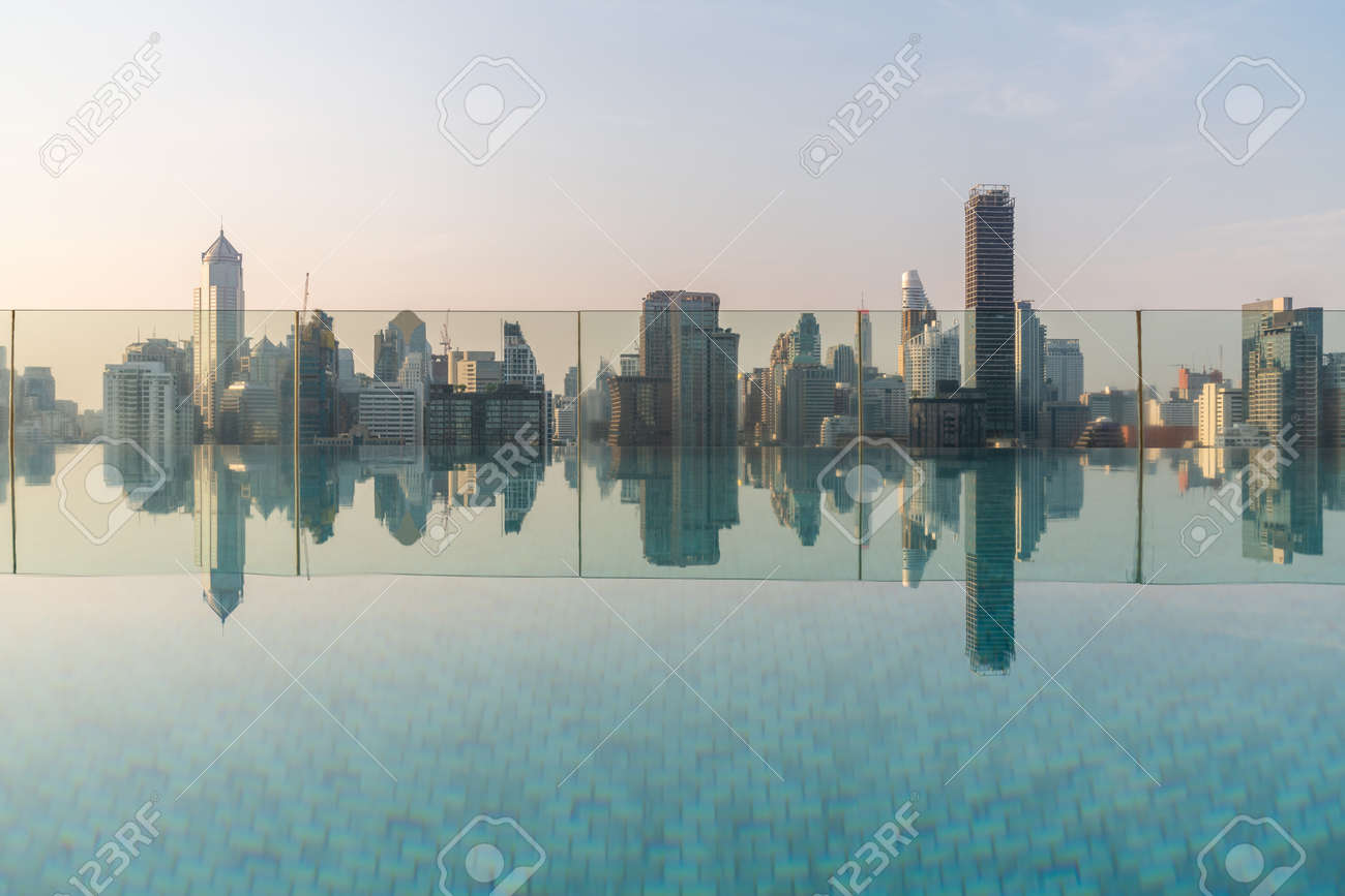 Cityscape and high-rise buildings in metropolis city with water reflection in the early morning . - 171906043