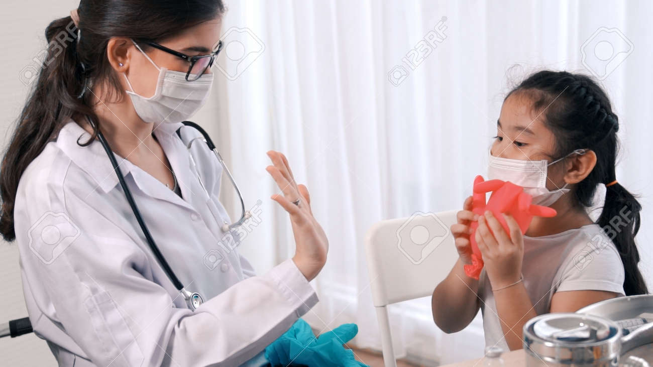 School girl visits skillful doctor at hospital for vaccination . Covid 19 and coronavirus vaccination center service concept . - 171940855