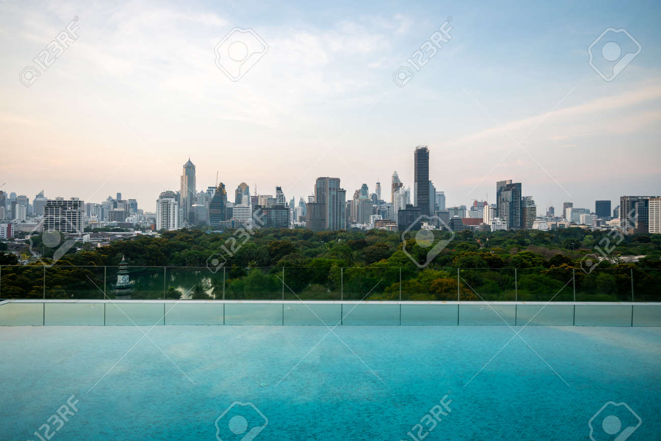 Cityscape and high-rise buildings in metropolis city with water reflection in the early morning . - 171940831