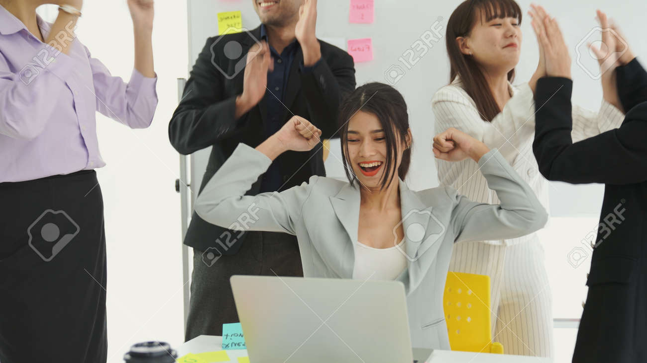 Business people celebrate success of proficiently finished project . Corporate business team collaboration concept . - 171925196