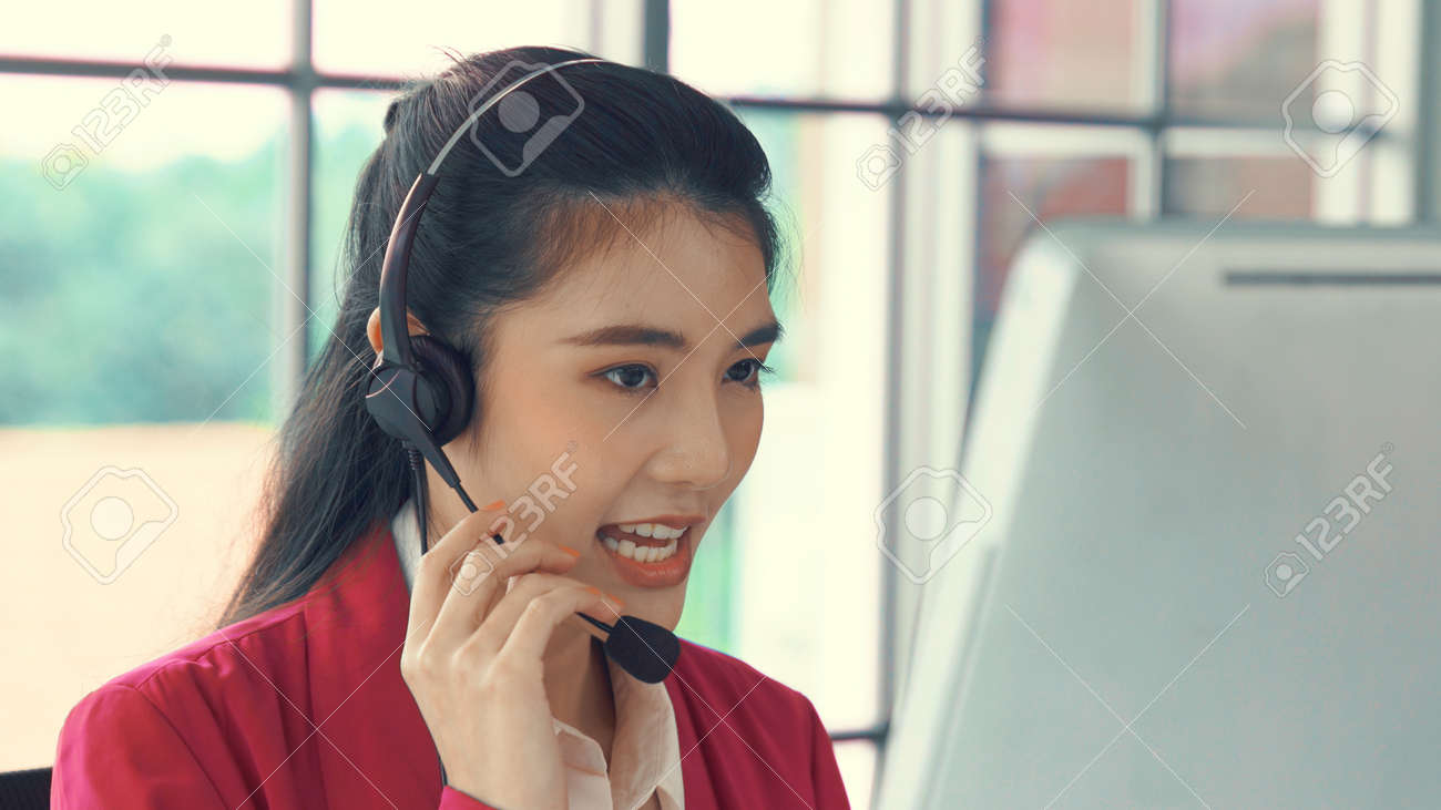 Businesswoman wearing headset working actively in office . Call center, telemarketing, customer support agent provide service on telephone video conference call. - 171929002