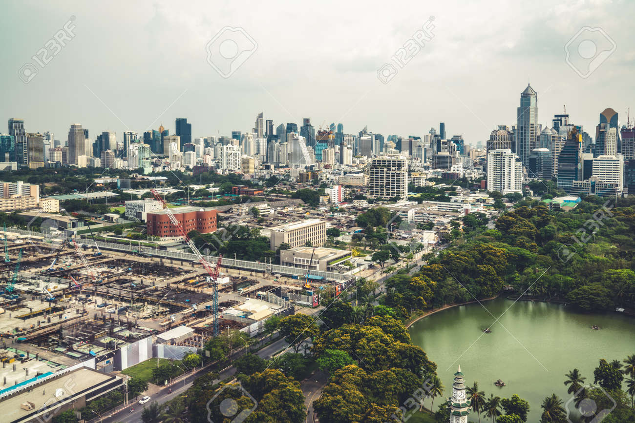 Panoramic view of cityscape and construction site in metropolis . Real estate development in downtown business district . - 171925589