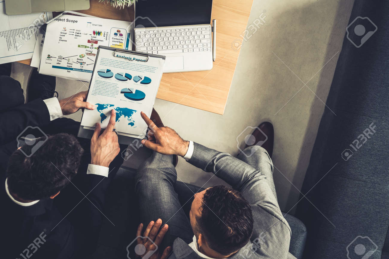 Businessman is in meeting discussion with another businessman partner in modern workplace office. People corporate business team concept. - 171929009