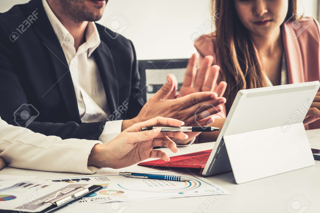 Businessman is in meeting discussion with colleague businesswomen in modern workplace office. People corporate business team concept. - 171932158